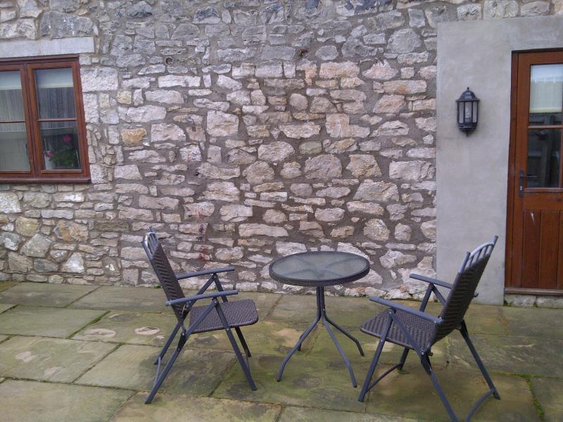Enclosed private patio area
