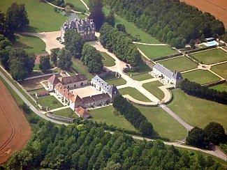 Aerial view of Chateau de la Trousse. Orangery on the right. Pool top right.
