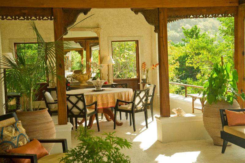 The Dining Room at the other end of the outside covered terrace looking over the sweep of the ocean