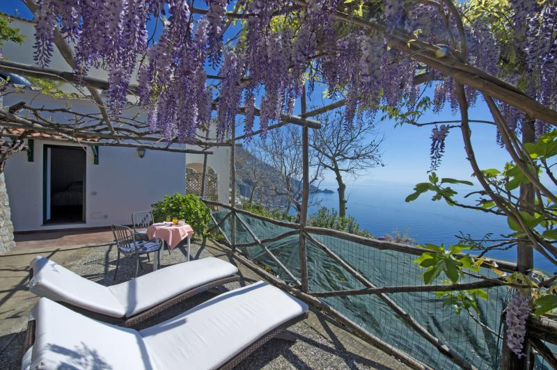 Our private garden among wisteria and lemon orchards scent at Villa Withe Daisy in Praiano, Priano