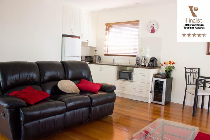 Leather lounge and kitchenette