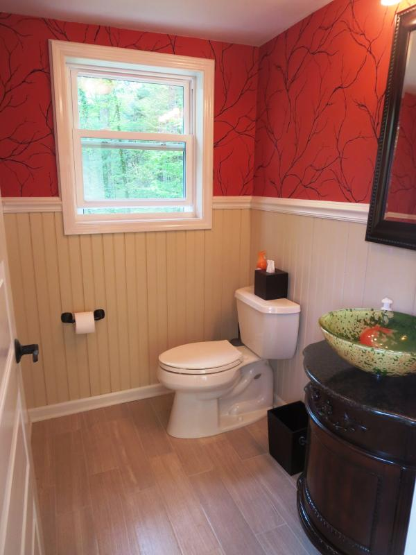 The half bath is conveniently located inside the back door off of the rear deck.