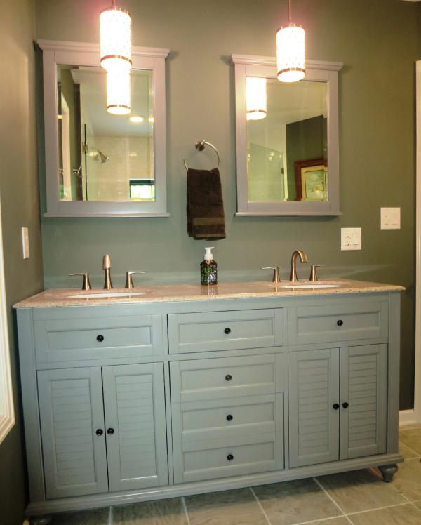 The third full bath has double sinks and loads of storage.
