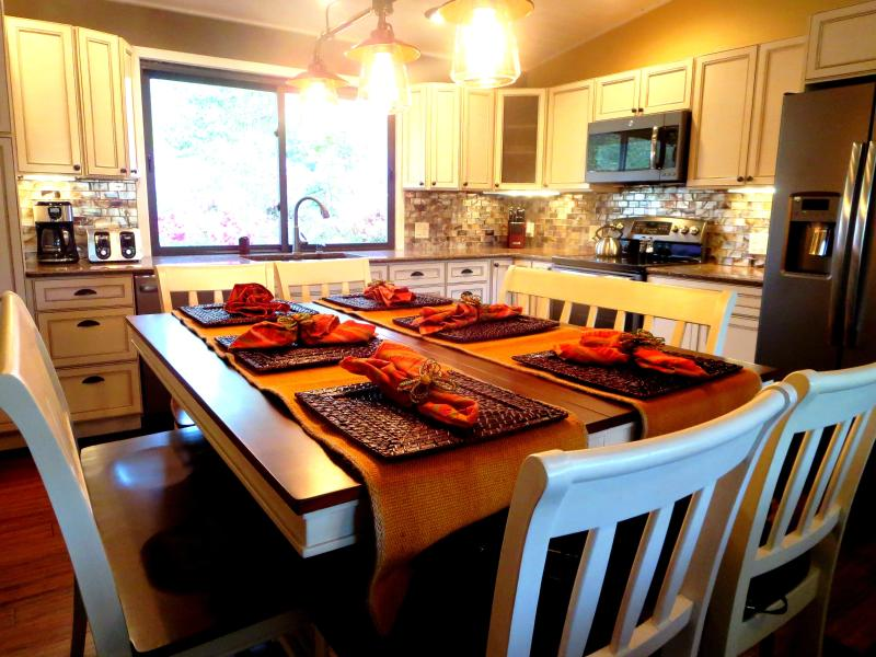 The counter height dining table seats 8 comfortably.