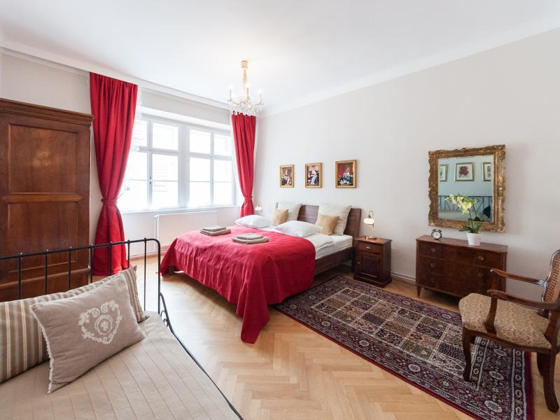 Red bedroom: one king size and one single bed