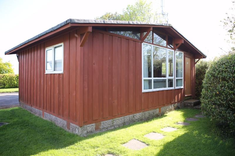 The chalet from the outside, private parking is included to the rear
