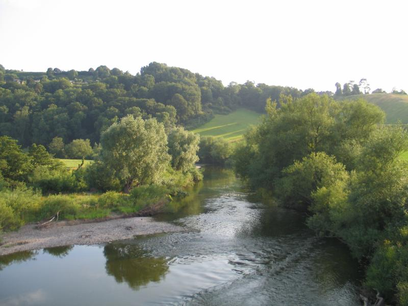The River Wye winds its way through lush green countryside.