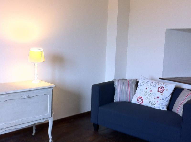 Large living room with 2 comfy sofas & views over the square & into the countryside