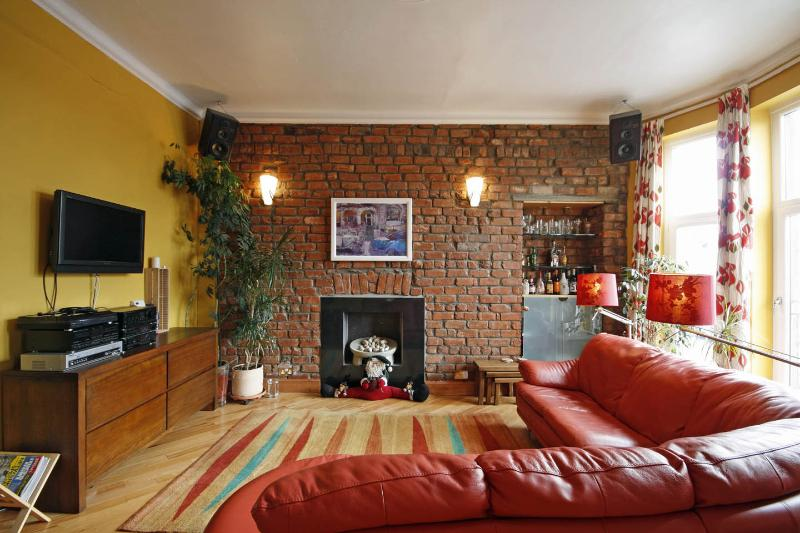 Living Room with feature wall - original handmade bricks from 1873!