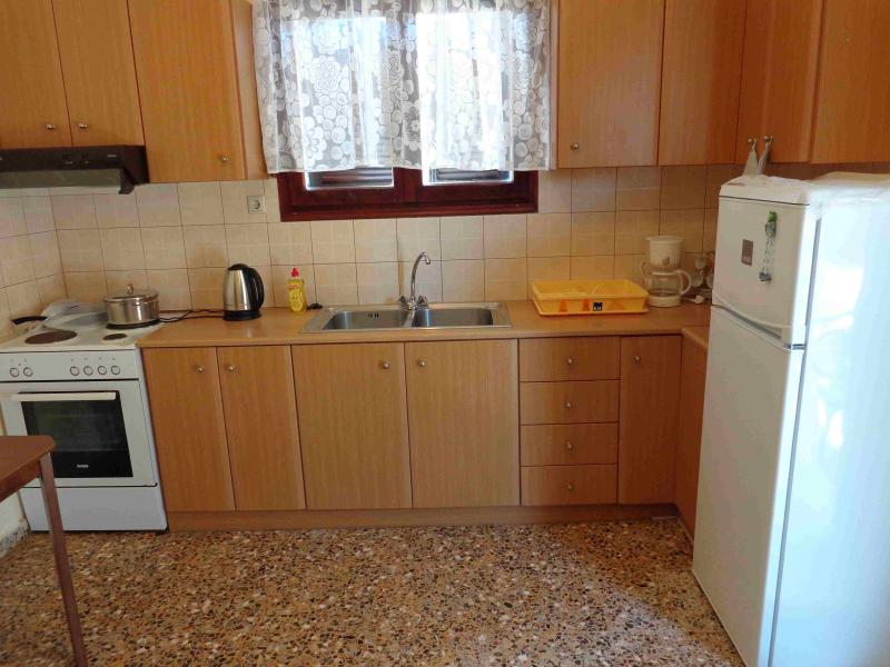 Kitchen with oven, refrigerator, toast maker, water boiler for coffee etc