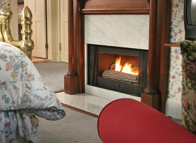 Each of the 2 bedrooms has a gas fireplace with an antique mantelpiece