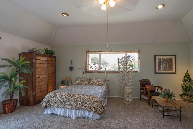 The beautiful penthouse  bedroom area with queen bed in the main room.
