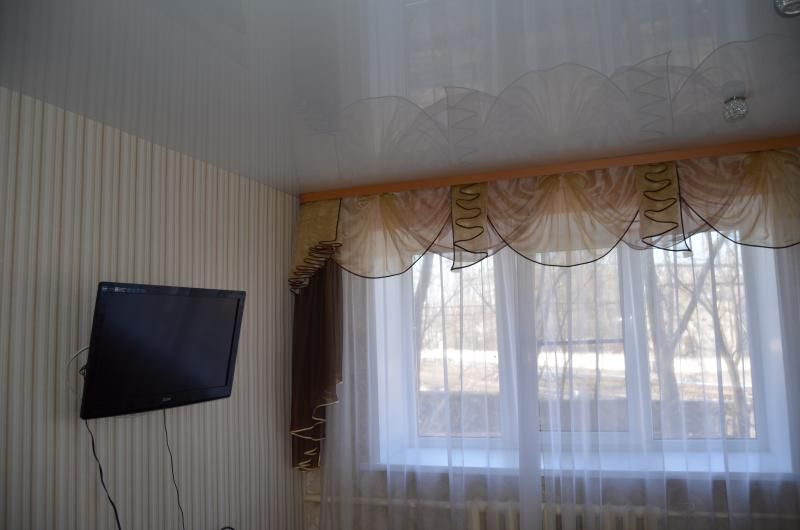 a room of gle is bed sofa television set dresser