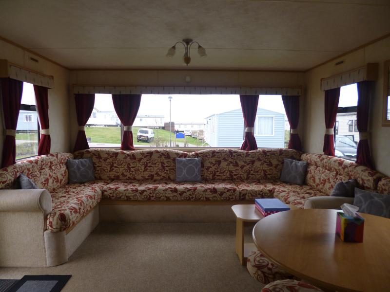 12ft wide spacious lounge. Double bed stored beneath the sofa