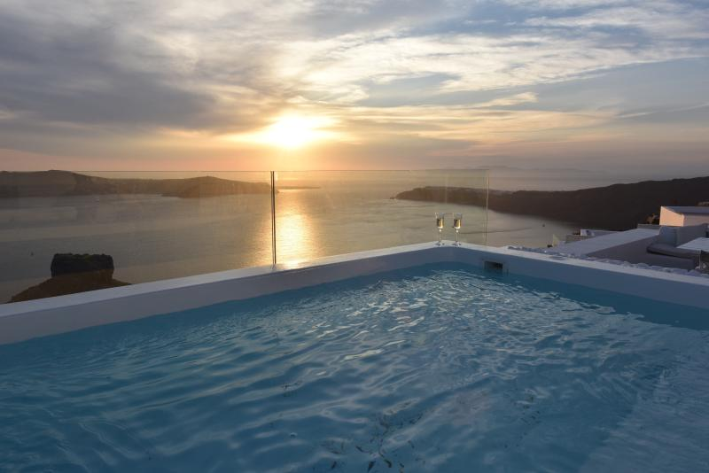 Roof top jacuzzi sunset view