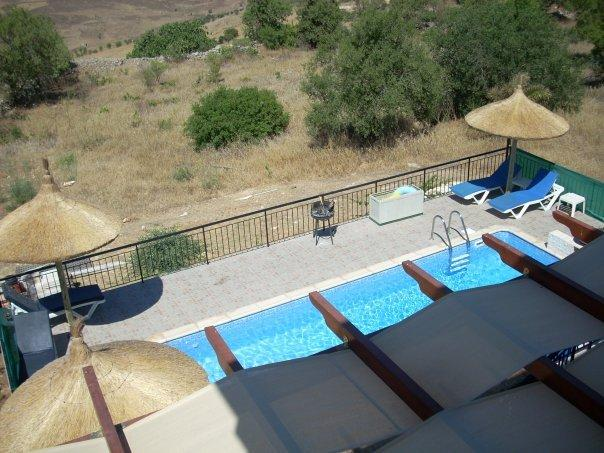 View of pool from main bedroom balcony