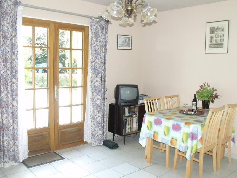 Dining Area set to welcome you. French windows lead onto the large garden, BBQ area and Pool