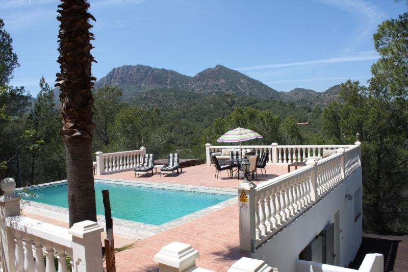 Rear view with pool, terrace and jacuzzi. Great view over Mount Garbi.