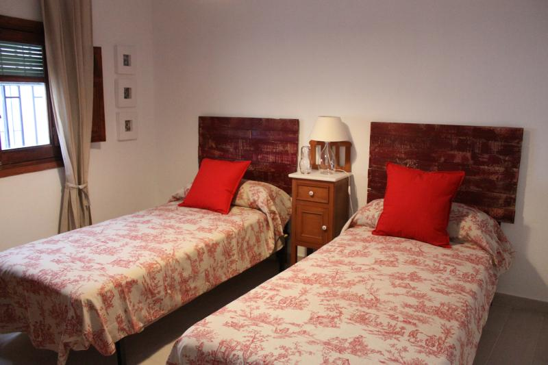Double Bedroom with window, wardrobe, nightsand, chair