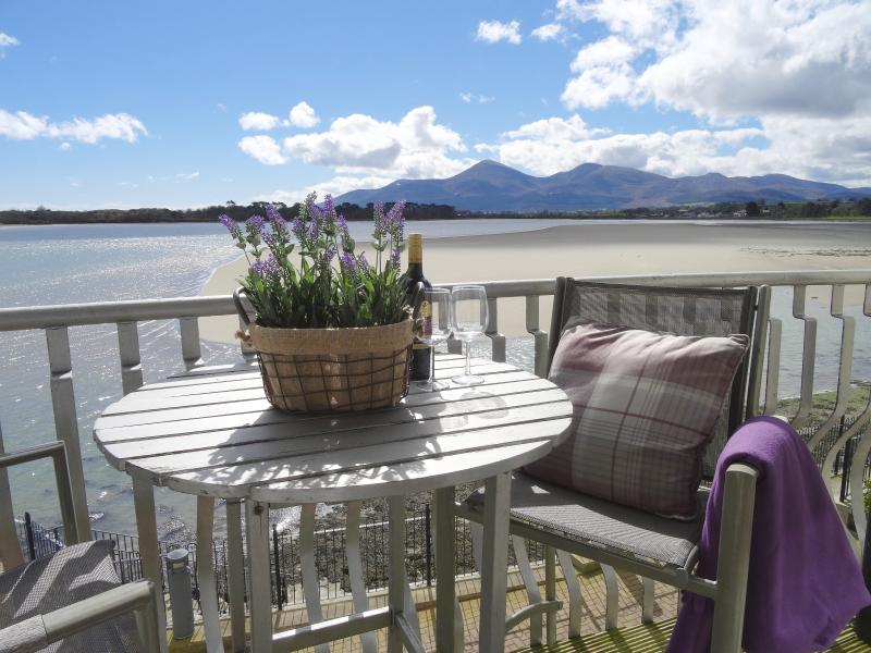 Enjoy the stunning views of the mountains and bay from the balcony