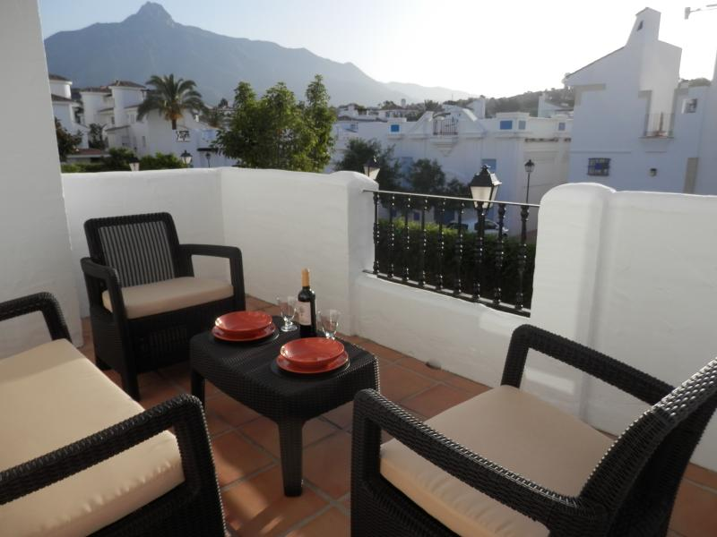 relaxing on the terrace with view of Sierra Blanca