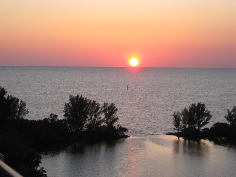 A spectacular sunset as viewed from your 8th floor Penthouse balcony