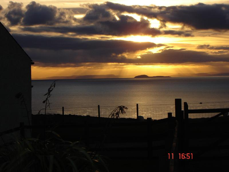 """An """"angry"""" sky over Sanda, taken from the garden ..... views to die for!"""