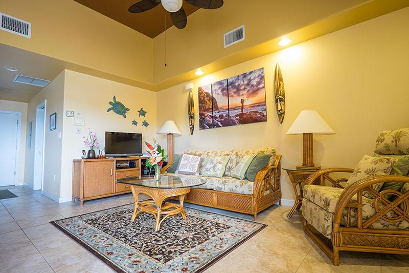 Living room with vaulted ceiling and touches of Hawaii everywhere.