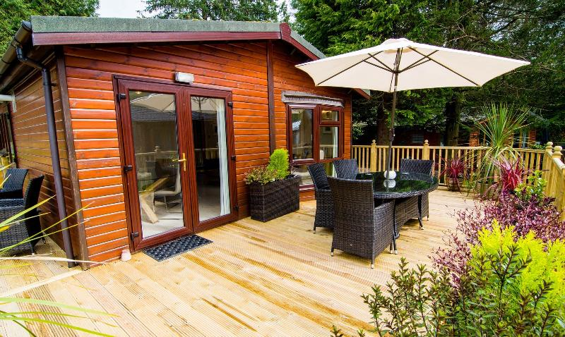 Huge decking area with top quality outdoor furnitue, for alfresco dining.......lake district weather