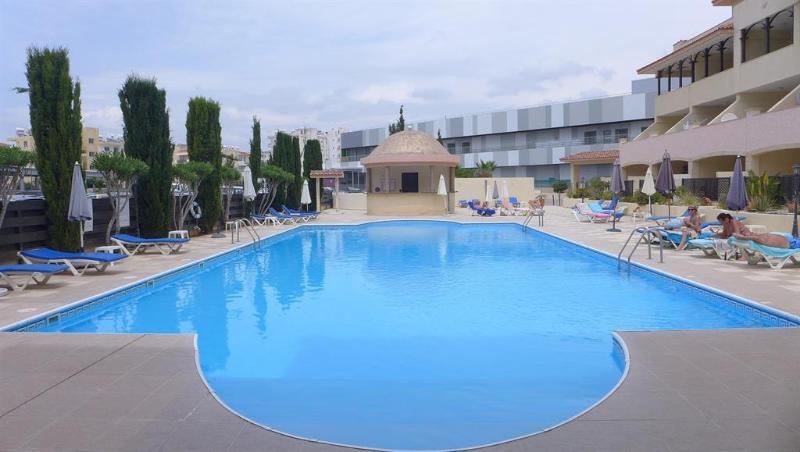 Swimming pool area with showers & sunloungers