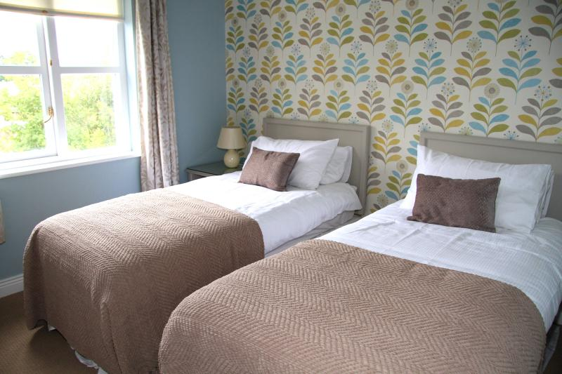 Twin Bedroom with quality bed linen.