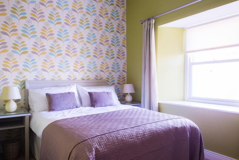 Double room with quality bed linen, wardrobe, chest of drawers, vanity area with mirror