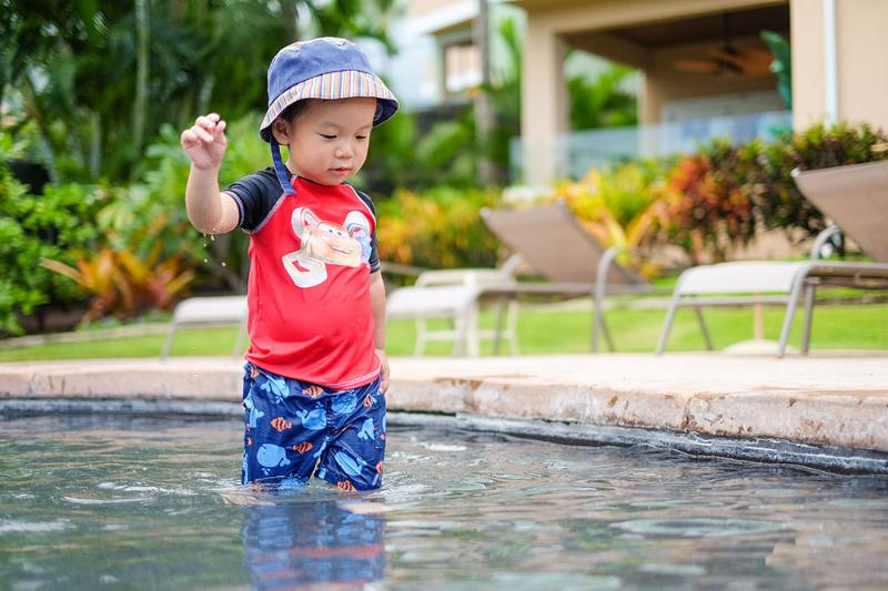 Our 2.5-year old son Ryan in the shallow pool section of the infinity pool.