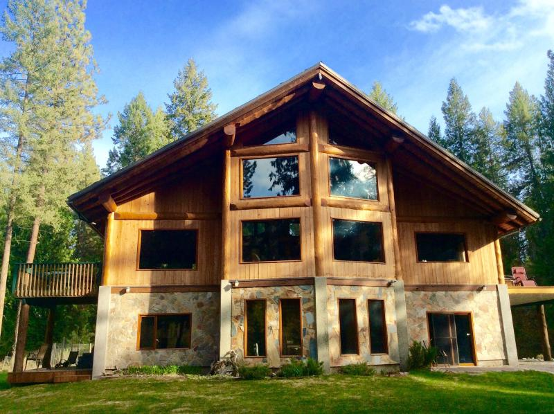 Two story riverfront log post and beam home.