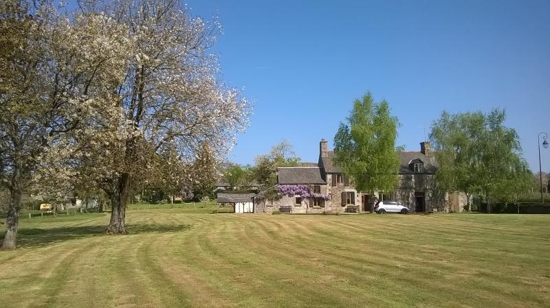 A great view of the house showing the spacious field.