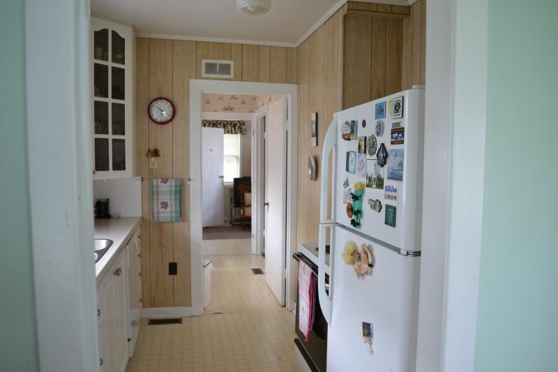 Kitchen, pantry with another sink,  and back den
