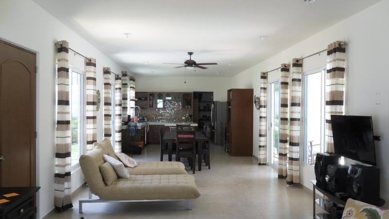 Large Great Room, Travertine Tiles Throughout Home