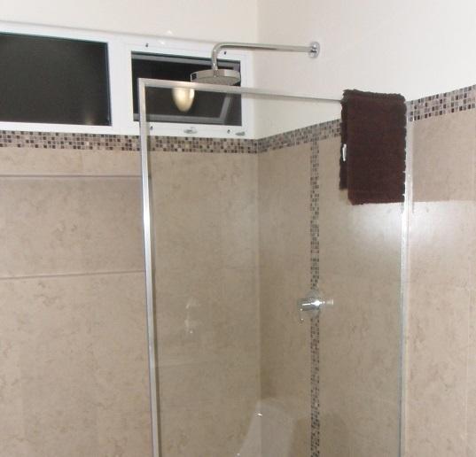 Helvex Rain Water Shower Heads in Each Bathroom