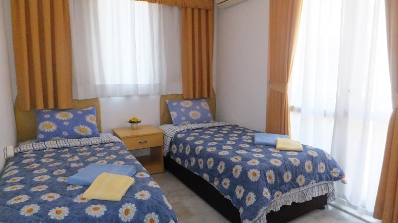 The Yellow Bedroom (Children bedroom) on level 2 of the villa with pool view - cot available as well