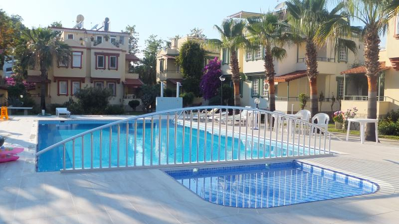 Shared pool at the Club Konak I with safety fence between children and adults pool