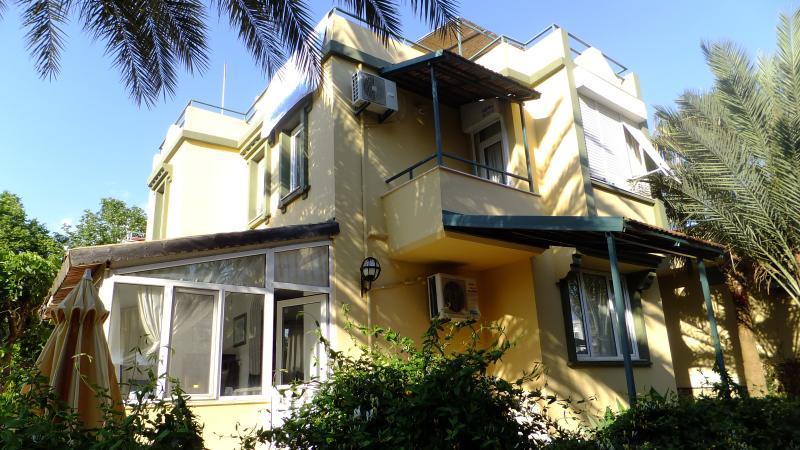 Side facade of the villa and patio