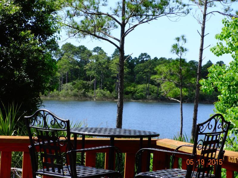 Picturesque bar stools and table with deck water view unit 2515