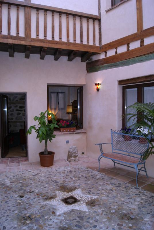 View of the private courtyard surrounded by rooms very comfortable apartment to enjoy .
