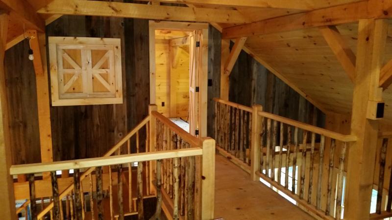 Upstairs bedroom and catwalk to sleeping loft