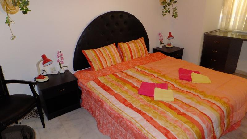 The Pink Bedroom at level 2 of the villa with garden view and balcony with pool view