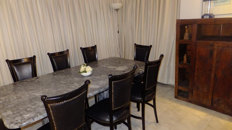 Marble dining table for 8 people and an antique commode