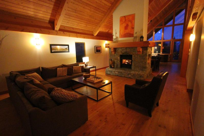 Lounge with two sided wood burning fireplace.