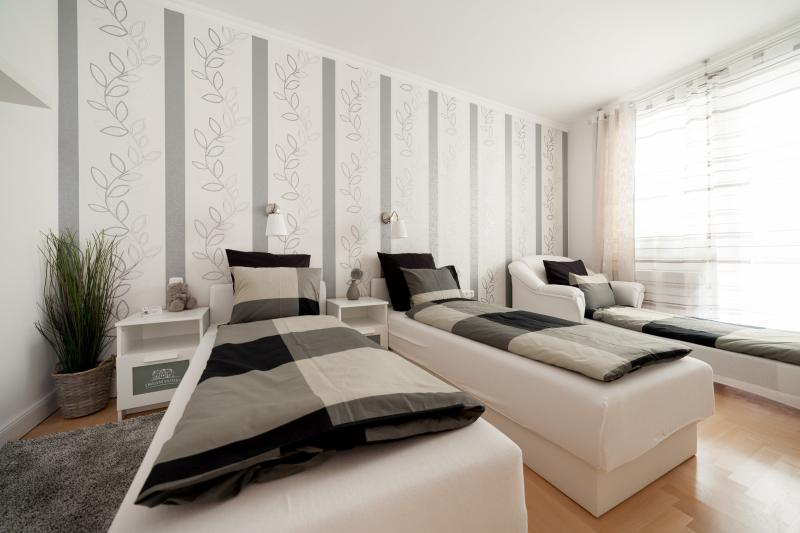 Chambre n ° 1 avec variation de lits simples