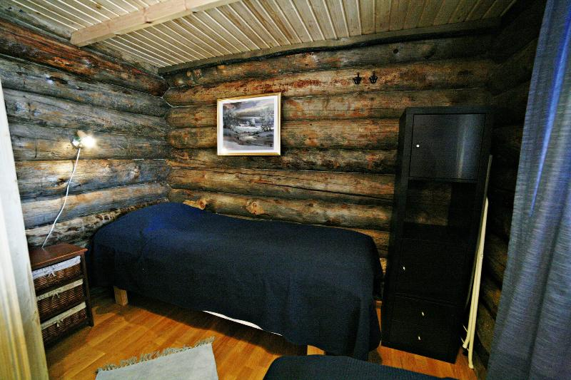 Two separate beds in the cottage bedroom