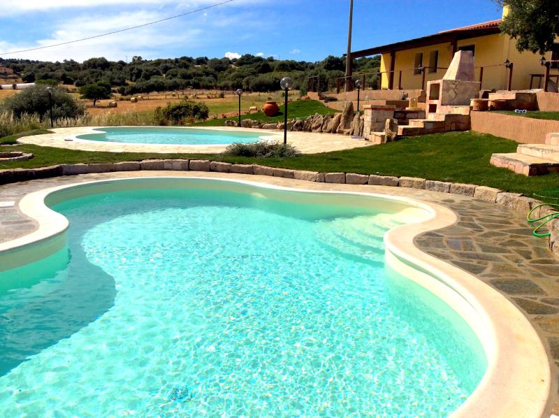 Swimming pools, house and barbecue